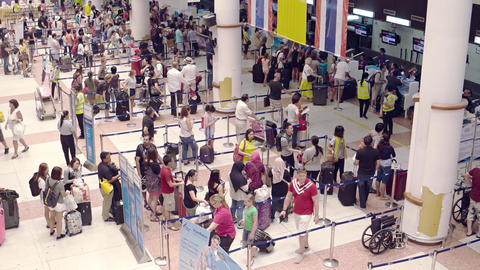 Travelers queued up at Phuket International Airport's ticketing counters Footage