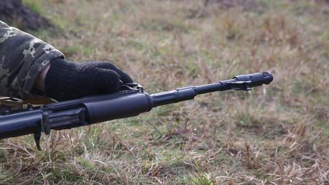 Soldier with a machine gun. Machine gun barrel Live Action