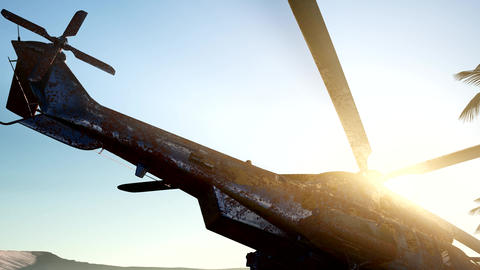 old rusted military helicopter in the desert at sunset Live Action