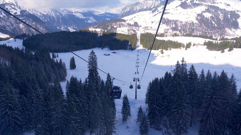 Ride in a cable car in the Alps on a winter's day - ENGELBERG, SWISS ALPS - Live Action