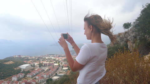 Woman traveller take photos with smartphone Live Action