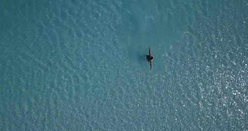 Top view on a person standing in blue water of the Salda lake, spin, 4k Live Action