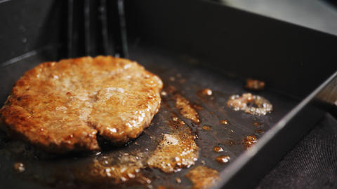 preparing tasty cutlet for hamburger on frying pan closeup Live Action
