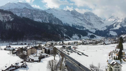 Wonderful snowy winter landscape in the Alps - aerial view Live Action
