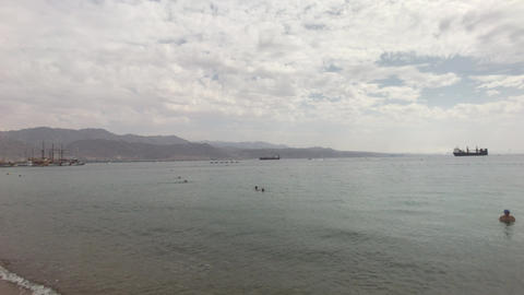 Eilat, Israel - October 24, 2019: Tourists bathe in the sea part 4 Live Action