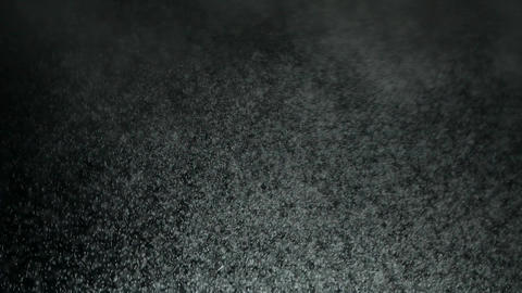 Abstract shot of flying snow and steam on black background. Snow and steam Live Action