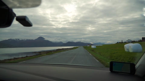 Driving a car on beautiful scenic asphalt Norway road in autumn with fjord view Live Action