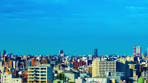 A timelapse of cityscape at the urban city in Tokyo wide shot panning Live Action