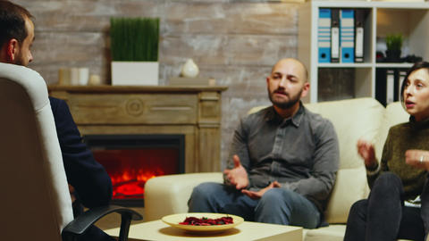 Therapist listening young couple talking about their relationship Live Action