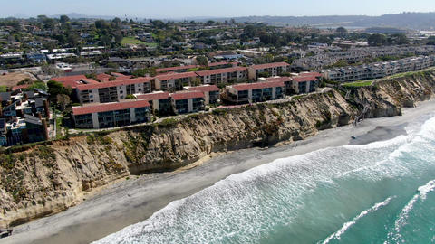 Aerial view of typical community condo next to the sea on the edge of the cliff Live Action