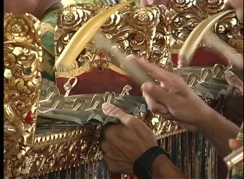 Skilled hands play an exotic musical Balinese instrument Stock Video Footage