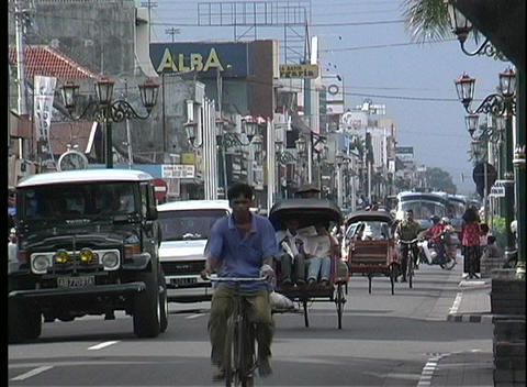 A view of people and vehicles traveling on a busy street Stock Video Footage
