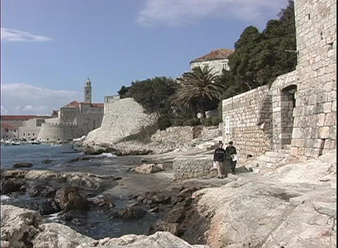 Cliffs and stone walls surrounding Dubrovnik, Croatia's coastal city Footage