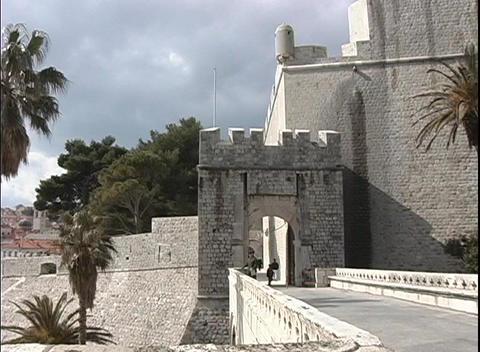 Pan-left of a castle on the Dubrovnik coastline in Croatia Stock Video Footage