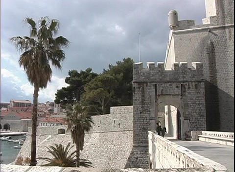 Pan-left of a castle on the Dubrovnik coastline in Croatia Stock Video Footage