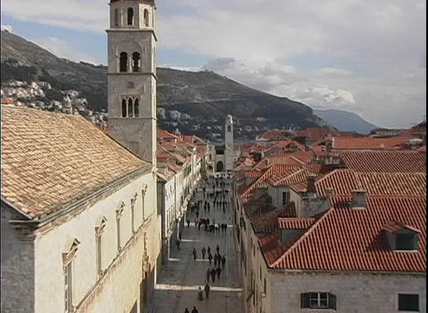 Zoom-out from of a steeple of a church, past rooftops of... Stock Video Footage