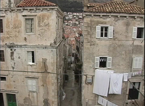 A birds-eye view of laundry hanging out to dry from buildings in Dubrovnik, Croatia Footage