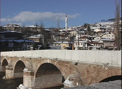 A lovely old stone bridge with arches provides passage over a canal in Bosnia Footage