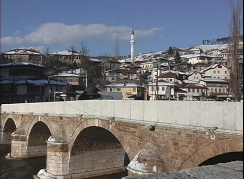 A lovely old stone bridge with arches provides passage... Stock Video Footage