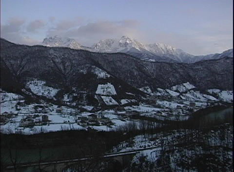 Pan-right over Bosnia's snow covered valley with snowy,... Stock Video Footage