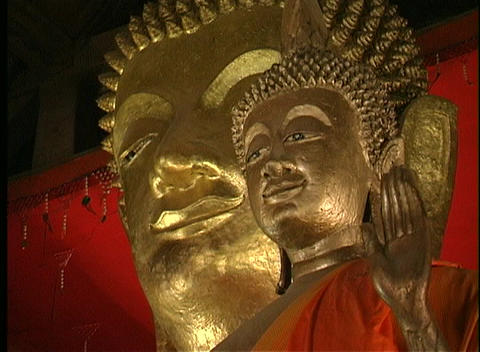 Close-up of a golden Buddha statue Stock Video Footage