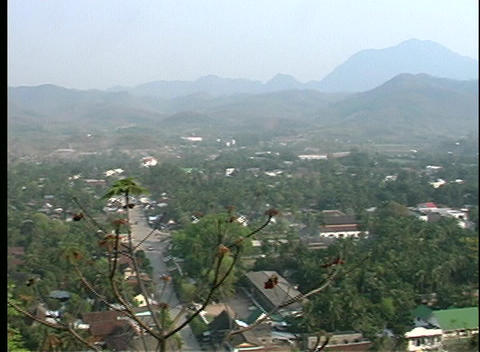 A pan-left, bird's-eye view of a town nestled in a lush... Stock Video Footage