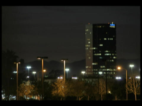 Time-lapse of a darkening sky over a city downtown Footage