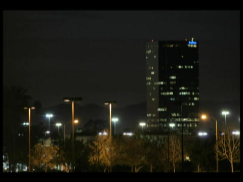 Time-lapse of a darkening sky over a city downtown Stock Video Footage