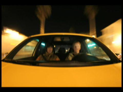 Time-lapse of two young men driving through a city in a car Stock Video Footage