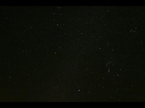 Time-lapse of twinkling stars moving in a dark sky Stock Video Footage