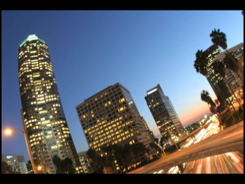 Time-lapse of city traffic under a darkening sky Stock Video Footage