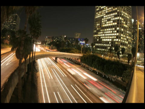 Time-lapse of city traffic on highways and overpasses at... Stock Video Footage