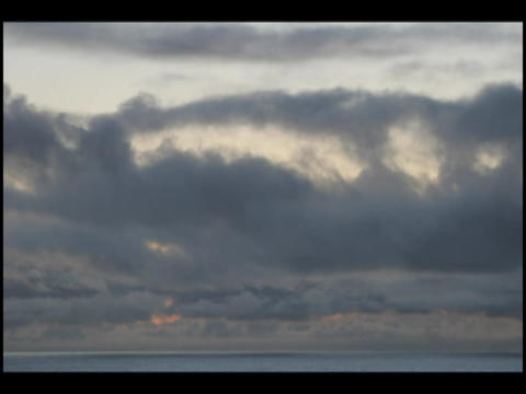 Time-lapse of clouds moving fast in a darkening sky Stock Video Footage