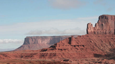 Moving clouds cast shadows over rock formations in Monument Valley, Utah Footage