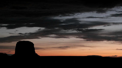 Time-lapse of a colorful darkening sky over Monument Valley, Utah Footage