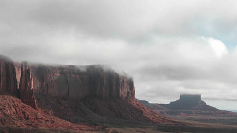 Clouds stream over rock formations in Monument Valley, Utah Footage
