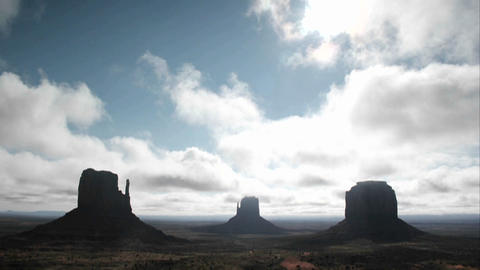White clouds move quickly over rock formations in... Stock Video Footage