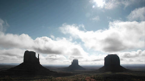 White clouds move quickly over rock formations in Monument Valley, Utah Footage