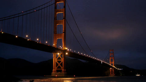 San Francisco's Golden Gate Bridge is illuminated in a... Stock Video Footage