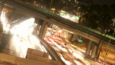 Time-lapse of Los Angeles city traffic on a major highway... Stock Video Footage