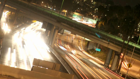 Time-lapse of Los Angeles city traffic on a major highway at night Footage