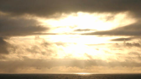 Clouds move quickly over the sun in a darkening sky Stock Video Footage