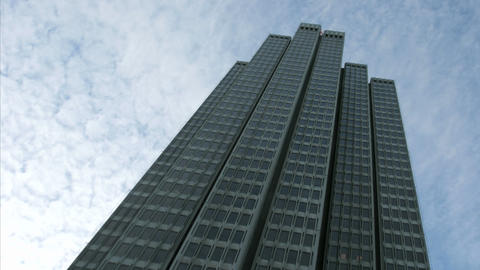 Thin clouds stream over an Embarcadero Center building in... Stock Video Footage