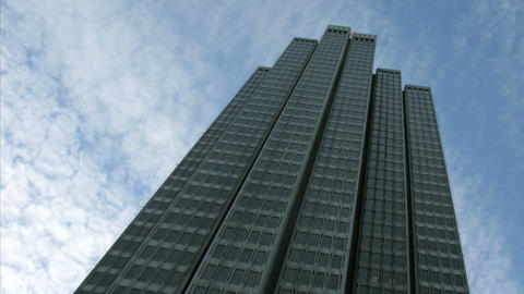 Thin clouds stream over an Embarcadero Center building in San Francisco Footage