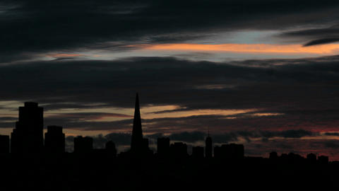 A colorful sky fades to darkness over the San Francisco skyline Footage