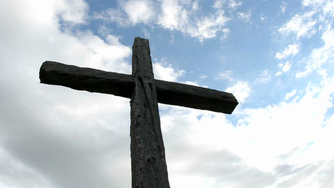 A cross in silhouette stands beneath swiftly moving... Stock Video Footage