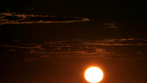 A Glowing Orange Sky Darkens As The Sun Slips Below The Horizon stock footage