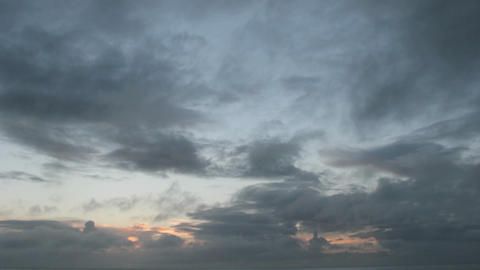 Clouds pass quickly in a colorful sky as it darkens Stock Video Footage