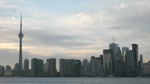 Clouds pass quickly during the day over the Toronto skyline Stock Video Footage