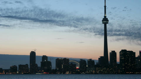 The Toronto skyline brightens as the colorful sky darkens Footage